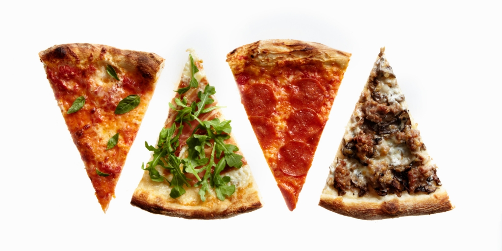 Four Slices of Pizza with Variety of Toppings