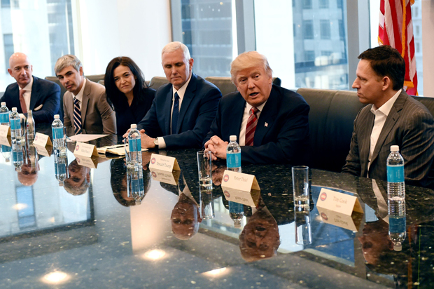 (L-R) Amazon's chief Jeff Bezos, Larry Page of Alphabet, Facebook COO Sheryl Sandberg, Vice President elect Mike Pence, President-elect  Donald Trump and Peter Thiel, co-founder and former CEO of PayPal at during meetings at Trump Tower in New York December 14, 2016. / AFP / TIMOTHY A. CLARY        (Photo credit should read TIMOTHY A. CLARY/AFP/Getty Images)