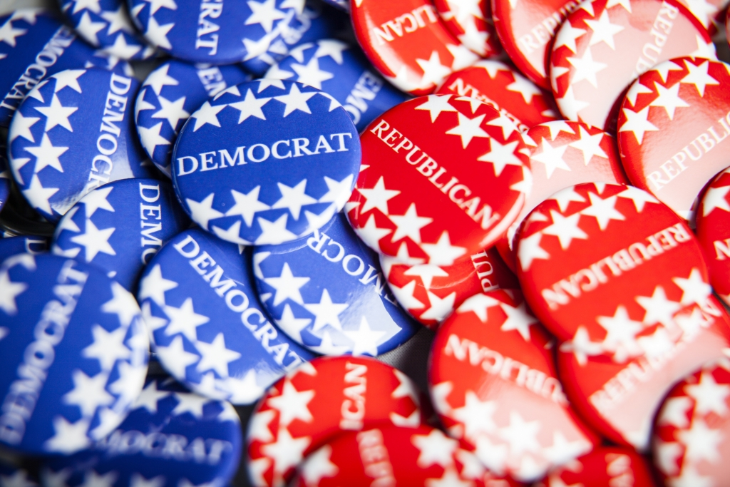 Close up of Vote election buttons, with red, white, blue and stars and stripes. Democrats and Republicans